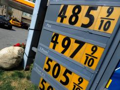 A sign shows gas prices nearing $5 a gallon for regular unleaded at a Shell service station on March 5, 2012 in Los Angeles.