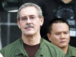Allen Stanford, left, leaves the Bob Casey Federal Courthouse March 6, 2012, in Houston.