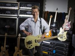 Eddie Van Halen poses with the newly designed Fender guitar called the Wolfgang, after his son photographed at his personal studio in Los Angeles just over two years ago.