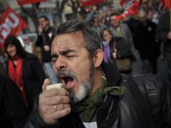 A Spanish trade unionist makes his voice heard during a march to protest against the government's tough new labor measures and cutbacks on Sunday in Pamplona, northern Spain.