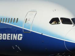 Capt. Randy Neville, a Boeing 787 test pilot, looks out the cockpit window as his Boeing 787 Dreamliner jumbo passenger jet taxis on the tarmac at Phoenix Sky Harbor Airport, on March 9, 2012.