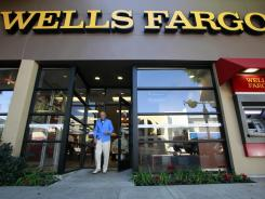 A customer exits a Wells Fargo branch in Los Angeles in this file photo. The Fed performed 'stress tests' on the nation's 19 largest banks.