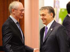 European Council President Herman Van Rompuy, left, and Hungary Prime Minister Viktor Orban at the start of a European Union summit in Brussels in January 2012.