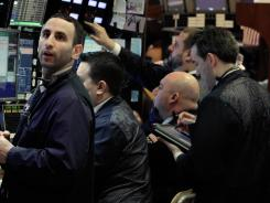 Traders on the floor of the New York Stock Exchange on March 9, 2012. Optimism over the U.S. economy is helping shore up global markets.