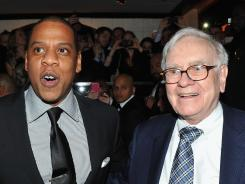 Hip-hop mogul Jay-Z and legendary investor Warren Buffett attend the grand reopening of Jay-Z's 40/40 Club on Jan. 18, 2012, in New York City.