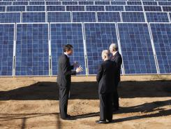 Recurrent Energy CEO Arno Harris, left, talks with California Gov. Jerry Brown, center, and Interior Secretary Ken Salazar Jan. 13 at the Recurrent Energy solar project in Elk Grove, Calif.