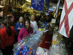 Dozens of people crowded into Emery's 5&10 in South Knoxville, Tenn., for a cash mob event in February.