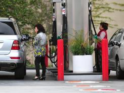 Drivers fill their tanks Tuesday in Monterey Park, Calif. There is more pain at the pump in California and other heavily populated states.