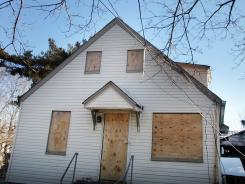 Abandoned: A foreclosed home stands boarded up in Islip, N.Y.