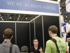 A job recruiter talks to attendees at the Game Developers Conference in San Francisco on March 8, 2012.
