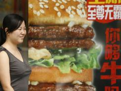 A woman walks past a McDonalds restaurant in Beijing in this file photo.