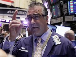 Trader Kenneth Polcari works on the floor of the New York Stock Exchange on March 15, 2012.