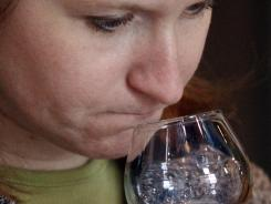 Patti Tavelli smells a glass of the rye whiskey made at Wigle Whiskey during the tasting session after a tour of the distillery in Pittsburgh on Feb. 11, 2012. The family-owned distillery is named after Philip Wigle, one of the leaders of the Whiskey Rebellion in the 1790s.