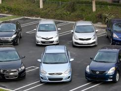 For our Shootout we drove (l-r, back row) Ford Fiesta, Toyota Yaris, Kia Rio, Honda Fit, (front row, l-r) Chevrolet Sonic, Hyundai Accent and Nissan Versa.