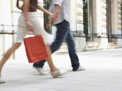 Luxury retailers are seeing an unexpected new shopping trend — men shopping like ladies and the women buying like guys.