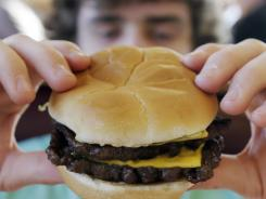 Aidan McLaughlin, of Yarmouth, Maine, enjoys a burger and fries at Wendy's restaurant in Falmouth, Maine in February 2012.