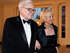 Warren Buffet and his wife, Astrid, arrive at the White House for a state dinner in honor of British Prime Minister David Cameron March 14, 2012.