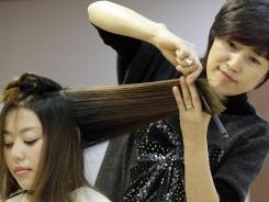 Jenny Park, right, cuts Diana Lee's hair at Kim Sun Young beauty salon in Chicago.