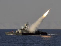 An Iranian navy vessel launches a missile during a drill near the Strait of Hormuz, on Jan. 1, 2012.