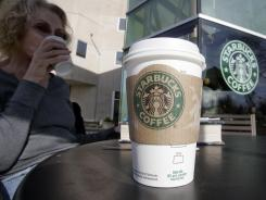 In Palo Alto, Calif., a Starbucks customer drinks coffee, which will soon be sold by a company-produced, single-cup machine for home brewing. Seattle-based coffee chain says the Verismo will be sold online and at some Starbucks cafes this fall.