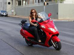 Ingrid Vanderveldt, advisory council member for Current Motors, on one of the company's super scooters.