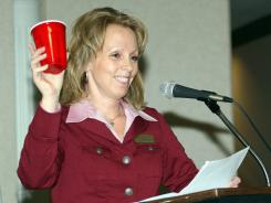 Raising a red Solo cup to a new year is Havre Area Chamber of Commerce outgoing President Kathy Palmer in January 2012 at the chamber's 103rd annual meeting in the Duck Inn Olympic Room in Havre, Mont.
