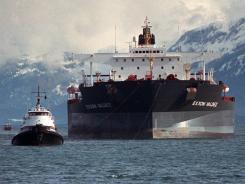 A tugboat pulls the crippled tanker Exxon Valdez away from Bligh Reef in Prince William Sound, Alaska, on April 5, 1989.