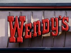 A Wendy's sign at a restaurant in Culver City, Calif., in January 2012. The company is changing the way it treats chickens and pigs used in its food in an effort to be more humane.