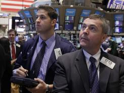 Traders work on the floor of the New York Stock Exchange in late February 2012.
