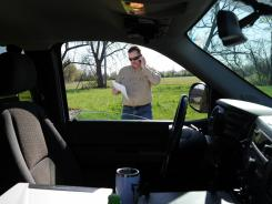 Ray Alford, 52, an Enbridge Energy employee, returns a phone call outside of his company truck while working near Hobart, Ind., on March 28.