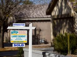 A sign in early January 2012 advertises another Phoenix area home sold, this one in Gilbert, Ariz.