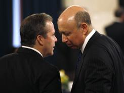 Lloyd Blankfein, right, of Goldman Sachs, talks with Gene Sperling, director of the National Economic Council, at a Feb. 14 event in Washington.