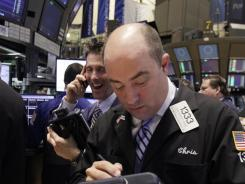 Trader Christopher Morie works on the floor of the New York Stock Exchange on March 13, 2012.