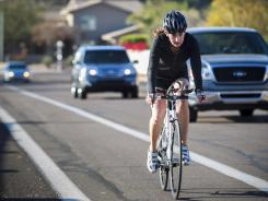 Susan Lacke bikes from her Phoenix home to work at Arizona State University in Tempe, Ariz., on March 14. After her car was wrecked, she decided not to replace it. In addition to biking, she also rides the bus.