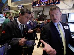Trading specialist on the floor of the New York Stock Exchange on Feb. 8, 2012.