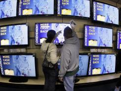 Shoppers look at televisions at a Best Buy store in Brentwood, Tenn., in this file photo.