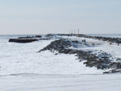 The frozen Port of Nome on March 15, 2012. The world's attention was on the iced-in city in early January when a multinational undertaking resulted in the first winter delivery of fuel. Storms prevented a normal late autumn delivery.