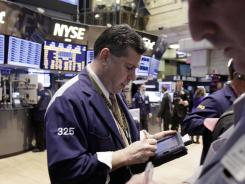 Traders on the floor of the New York Stock Exchange on Feb. 28, 2012.