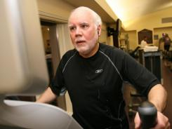 Elliptical: Daryl Martin, 60, executive director of Swiss Village, which ties deductibles to health goals, uses the elliptical machine in the early morning hours at the Swiss Village Wellness Pavilion