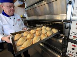 Tony Henshaw takes pasties out of the oven March 3 at the World Cornish Pasty Championships in St Austell, Cornwall, near the southwest tip of Britain.