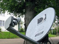 A DirecTV satellite dish in a residential area adjoining downtown Jackson, Miss.