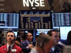 Traders work on the floor of the New York Stock Exchange on April 2, 2012 in New York City.