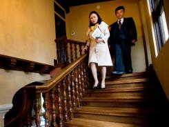Stanley Lo, right, a Realtor in Burlingame, Calif., shows a $4.4 million home to China native Lee Xiao Jun.