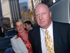 Former Tyco CEO Dennis Kozlowski enters Manhattan State Supreme Court in March 2004.