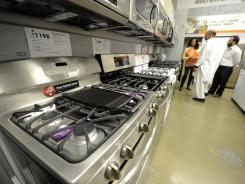 Home Depot employee Spring Barron helps customers shop for ovens in the appliance department.