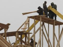 Workers build a home in Newtown, Pa. in February.