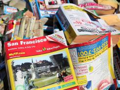 A pile of phone books sits in the back of a pickup truck in San Francisco.