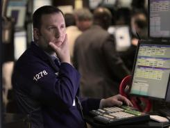 A trader works on the floor at the New York Stock Exchange in New York in February 2012.