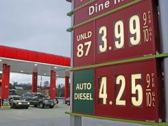 Prices are posted Monday at a gas station in Breezewood, Pa.