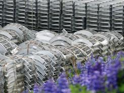 Stacks of fabricated aluminum are stored at Alcoa's Fjardaal aluminum smelter in Reydarfjordur, Iceland, in July 2011. Alcoa reported quarterly financial results April 10, 2012.